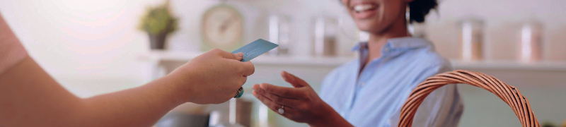 Woman making a transaction with a card